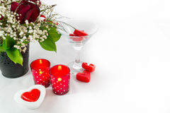 Valentines Day Rose Bouquet and Heart shaped Candles on white Stock Images