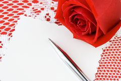 Valentines day roses. With blank note and pen Royalty Free Stock Photography