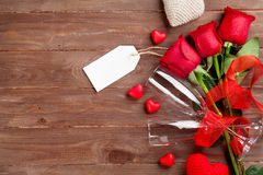 Valentines day roses bouquet and champagne glasses Stock Photo