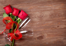 Valentines day roses bouquet and champagne glasses Stock Photos