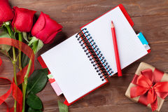 Valentines day roses, gift box and notepad Stock Photos