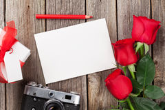 Valentines day roses, photo frame and camera Royalty Free Stock Photos