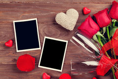 Valentines day roses, photo frames and champagne glasses Royalty Free Stock Image