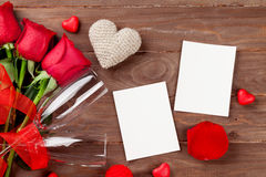 Valentines day roses, photos and champagne glasses Stock Photography