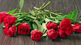Valentines day's arrangements with red roses and heart. Over gray background stock video footage