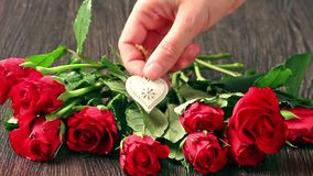 Valentines day's arrangements with red roses and heart. Over gray background stock video