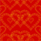 Valentines day seamless texture of gold hearts red background vector Royalty Free Stock Images