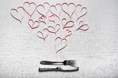Valentines day set with silverware. The concept of Valentine Day. Wooden white background with red hearts. The concept of Valentine Day Royalty Free Stock Image