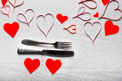 Valentines day set with silverware. The concept of Valentine Day. Wooden white background with red hearts. The concept of Valentine Day Stock Photo