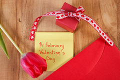 Valentines Day on sheet of paper, tulip, love letter and gift, decoration for Valentines Stock Photos