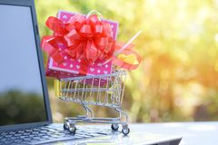 Valentines day shopping and Gift Box Pink present box with red ribbon bow on shopping cart Shopping online royalty free stock photos