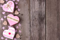 Valentines Day side border of heart-shaped gift boxes on wood Stock Images
