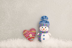 Valentines Day. Snowman on snow. Love concept Stock Photos
