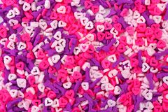 Valentines Day sprinkles background with hearts and cupids arrows Royalty Free Stock Photos