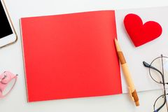 Valentines day and Sweetest day, love and red. Concept. Copy space for text with notebook and mobile phone stock images