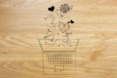Valentines day symbols flying out of laptop Stock Photo