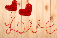 Valentines Day. Symbols of love -  two knitted hearts Royalty Free Stock Images