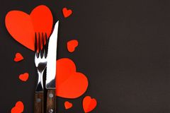 Valentines day table setting with knife, fork and hearts/ Holidays background/ Valentines day background - Image stock image