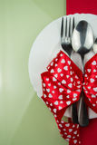 Valentines day table setting with plate, fork, red ribbon and hearts Stock Images