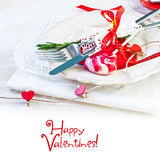 Valentines day table setting with plate, knife, fork, red ribbon Stock Images