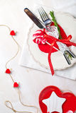 Valentines day table setting with plate, knife, fork, red ribbon Royalty Free Stock Photos