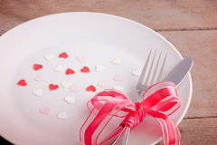 Table Setting Background valentines day table setting with plate, fork, knife, red heart