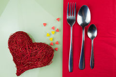 Valentines day table setting with plate red ribbon and hearts Stock Images