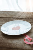 Valentines day table setting with plate,  red ribbon and hearts Stock Photos