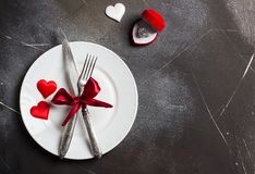 Valentines day table setting romantic dinner marry me wedding engagement ring Royalty Free Stock Photo