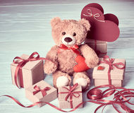 Valentines Day. Teddy Bear Love.Gift boxes on wood Royalty Free Stock Photography