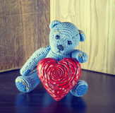 Valentines Day. Teddy Bear Loving cute with red hearts sitting alone. Vintage. Stock Images