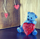 Valentines Day. Teddy Bear Loving cute with red hearts sitting alone. Vintage. Royalty Free Stock Photo