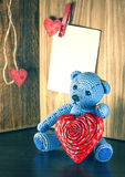 Valentines Day. Teddy Bear Loving cute with red hearts sitting alone. Vintage. Retro romantic styled on wooden background. Copyspase Stock Photos