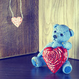 Valentines Day. Teddy Bear Loving cute with red hearts sitting alone. Vintage. Retro romantic styled on wooden background. Copyspase Royalty Free Stock Photography