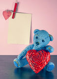 Valentines Day. Teddy Bear Loving cute with red hearts sitting alone. Vintage. Retro romantic styled on wooden background. Copyspase Royalty Free Stock Image