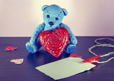 Valentines Day. Teddy Bear Loving cute with red hearts sitting alone. Vintage. Royalty Free Stock Image