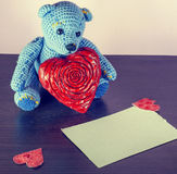 Valentines Day. Teddy Bear Loving cute with red hearts sitting alone. Vintage. Retro romantic styled on wooden background. Copyspase Stock Photography