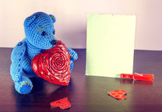 Valentines Day. Teddy Bear Loving cute with red hearts sitting alone. Vintage Stock Images