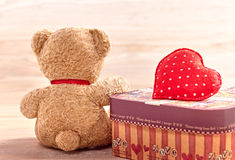 Valentines Day. Teddy Bear Loving with Heart and Gift. Retro. Stock Photo