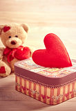 Valentines Day. Teddy Bear Loving with hearts and. Valentines Day. Teddy Bear Loving cute with red hearts sitting alone waiting for love. Vintage. Retro romantic Royalty Free Stock Photo