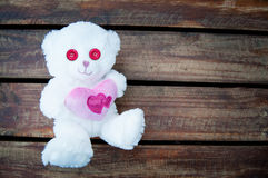 Valentines Day Teddy Bear Pink. Valentines day teddy bear with pink love heart and pinks eyes Royalty Free Stock Images