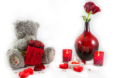 Valentines Day Teddy bear, Rose bouquet in vase, hearts and candles on white background Royalty Free Stock Photos