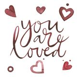 Valentines Day text. You are loved. Romantic quote for design greeting cards, tattoo, holiday invitations. Watercolor. Pink set of elements for Valentine`s day Royalty Free Stock Image