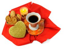 Valentines day theme. A cup of coffee with a box of cookies and a candle on red textile Royalty Free Stock Photos