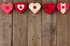 Valentines Day top border of red heart-shaped gifts over wood Stock Image