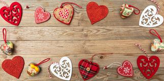 Valentines day. Top view, flat lay of various hearts, wooden background. Valentines day. Top view and flat lay of various shapes of hearts against wooden stock image