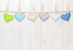 Valentines day toy hearts hanging on rope Royalty Free Stock Photos
