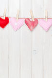 Valentines day toy hearts hanging on rope Royalty Free Stock Image