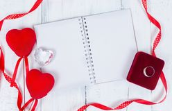 Valentines day toy hearts and notepad for your text. Top view on wooden table stock photo