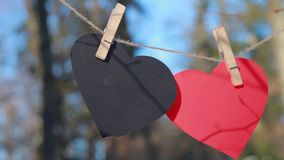 Valentines day, Valentine`s day,Love. Two red heart, symbol of love, Happy Valentines Day background. Decorative white wooden hearts on grey rustic wooden stock footage